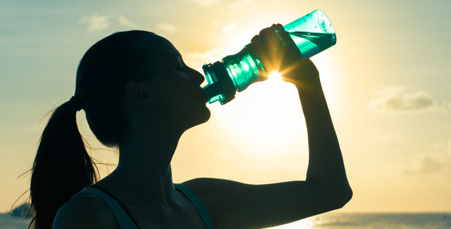 Woman drinking with water bottle