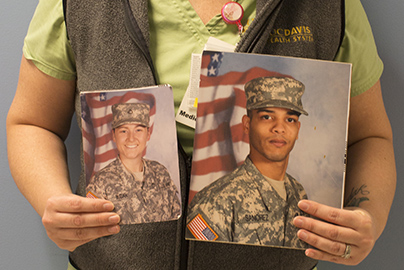 nurse veteran holding military portraits