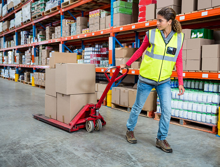 woman pulling hand truck
