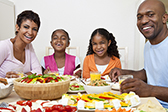 A healthy family dinner includes fruits and vegetables © iStockphoto