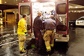 Photograph of emergency workers loading burn patient into ambulance © iStockphoto