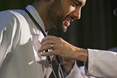 New medical student receives his stethoscope from Dr. Freischlag © UC Regents