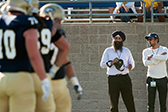 Photo of UC Davis football game with team physicians observing players © UC Regents