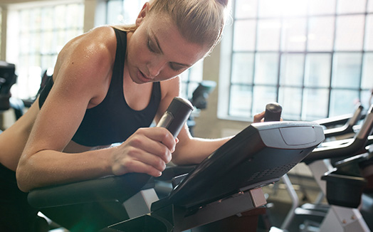Girl on a stationary bike in a gym