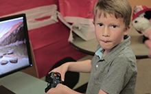 Caleb playing a video game at the MIND Institute
