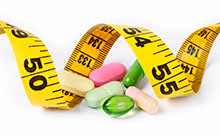 Measuring tape with diet pills