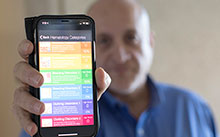 Dr. Rashidi showing the app on his phone