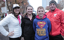 Hunter David, who had surgery at UC Davis Children's Hospital to remove a pilocytic astrocytoma brain tumor, poses with his family at the 2015 MaraFUNrun in Sacramento